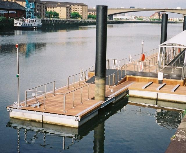 Think they put in the upright poles, then the pontoons attached with D rings so they raise and lower with tides.